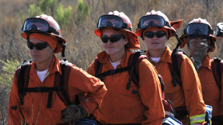 Female prison inmate crews hike into area for brush-clearing at Mission Trails Regional Park.