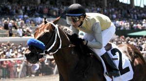 Jockey Tiago Pereira leds his horse Hawk's Eyes to a win in the first race.