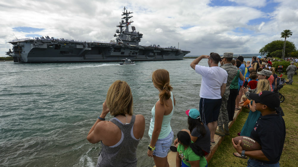 Crowds watch as the USS Ronald Reagan leaves Pearl Harbor. Navy photo