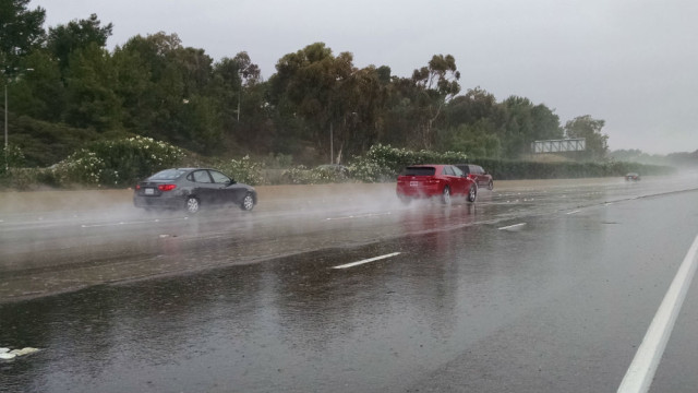 Vehicles driving through pouring rain on Interstate 5 north in University City last Sunday. Photo by Chris Jennewein