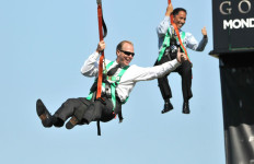 San Diego Mayor Kevin Faulconer and City Council President Todd Gloria soar above the temporary skyline of Gotham City.