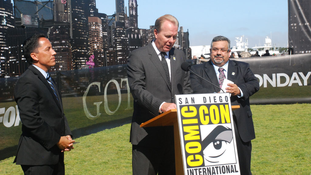 San Diego Major Kevin Faulconer, accompanied by City Council President Todd Gloria, left, and Comic-Con executive David Glanzer, right, talks about the economic boost that the gathering creates for the city.