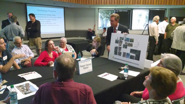 SANDAG's John Haggarty listens as community members ask about trolley station designs. Photo by Chris Jennewein