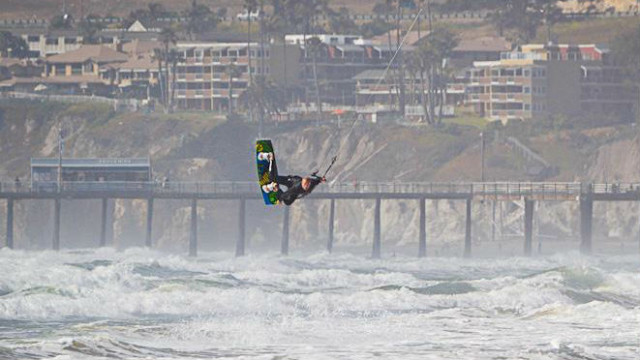 Dizzle co-founder and CEO Will Caldwell kitesurfing.