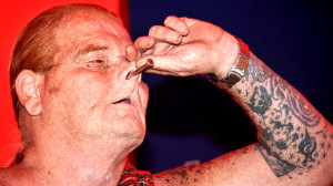 "Red Stuart displays large nail ""hammered"" into his head via nostril in Worlds of Wonders tent at San Diego County Fair."