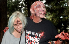 Patti and Bill Shenk of San Diego prepare for the 8th annual Zombie Walk at the 2014 Comic-Con.