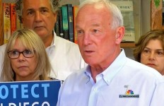 Former Mayor Jerry Sanders stands up with small business owners to oppose council action on  minimum wage proposal.  The Chamber of Commerce has submitted signatures to challenge the council's action. Photo credit: NBC7SanDiego via Twitter.