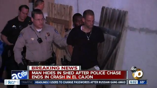 Suspect under arrest after chase. Image from 10News broadcast