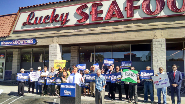 Carl DeMaio with Tom Hom, right, outside Luck Seafood in Mira Mesa. Photo by Chris Jennewein