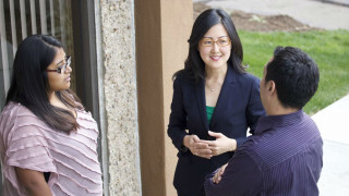 City Council candidate Carol Kim talks with supporters. Campaign photo
