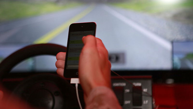 Distracted driving is dangerous. Photo via Wikimedia Commons