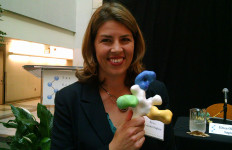 Dr. Erica Ollmann Saphire of the Scrips Research Institute holds a model of the Ebola virus. Photo by Chris Jennewein