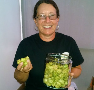 Lyle Kafader, the owner of ZP Growers, with some of the hops she grows in Valley Center. Photo by Chris Jennewein