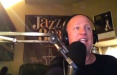Announcer Vince Outlaw in the Jazz 88.3 studio. Image from video