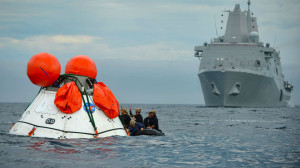 Sailors from the amphibious transport dock ship USS Anchorage and Navy divers participate in the recovery test for the NASA Orion program.  Navy photo by Corey Green