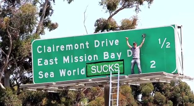 Celeb Stevo-O changes SeaWorld sign on  Interstate 5. Photo credit: Steve O via YouTube