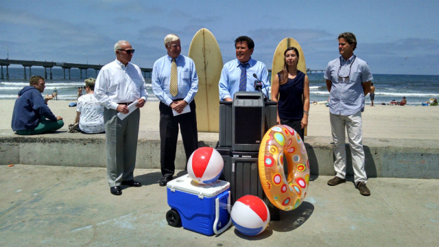 Jerry Sanders, left, Greg Cox, Marty Block, Megan Baehrens and Serge Dedina at a press conference in Ocean Beach. Photo by Chris Jennewein