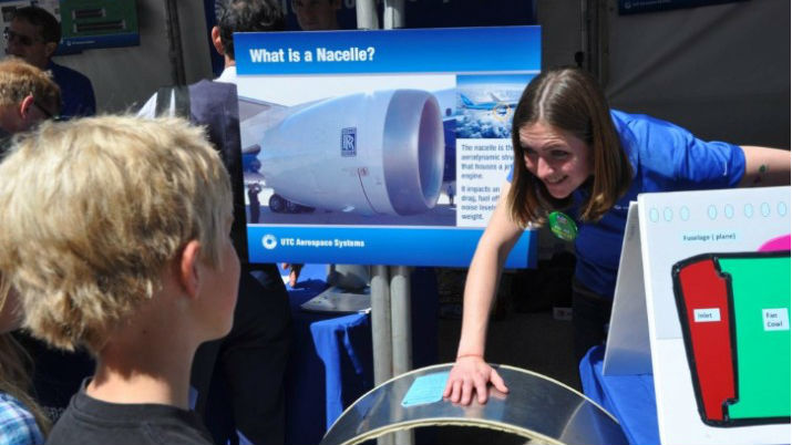 UTC Aerospace Systems associate engineer Clare McGlory explains how a nacelle works to a young attendee at the Festival of Science & Engineering in San Diego. Photo courtesy UTC