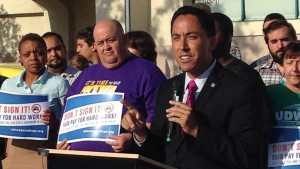 Todd Gloria, San Diego City Council president, at a rally Thursday for the minimum wage and sick day boost. Photo credit: @kirstenclemons, via Twitter.