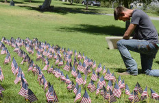 Ryan Hallahan, a former Marine, stops by the 9/11 flag memorial  on Thursday afternoon. Photo credit: Chris Stone