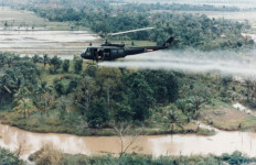A helicopter spaying Agent Orange in Vietnam. Army photo via Wikimedia Commons