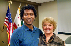 Foster child and university student Julius Williams with Karen Haynes, president of Cal State San Marcos. Photo by Chris Jennewein