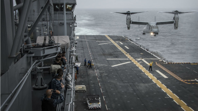 A Marine Corps MV-22 Osprey carrying distinguished Peruvian visitors prepares to land on the flight deck of the USS America. Navy photo