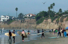 Surfers at Pacific Beach. Photo by Tim Shell via Wikimedia Commons