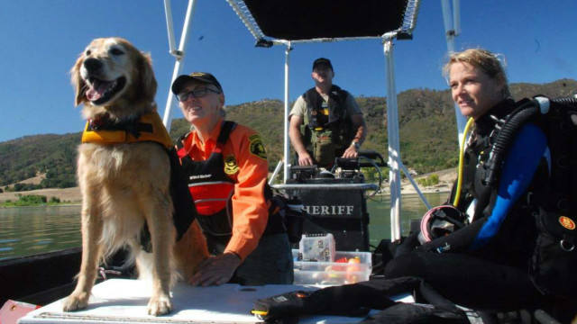 Volunteers with the Sheriff's Search and Rescue (SAR) K-9 Unit on Lake Henshaw. Courtesy of Sheriff's Department