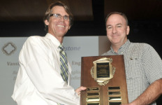 Head of School Kevin Yaley, left, presents a plaque to Chris Harrington. Courtesy Francis Parker