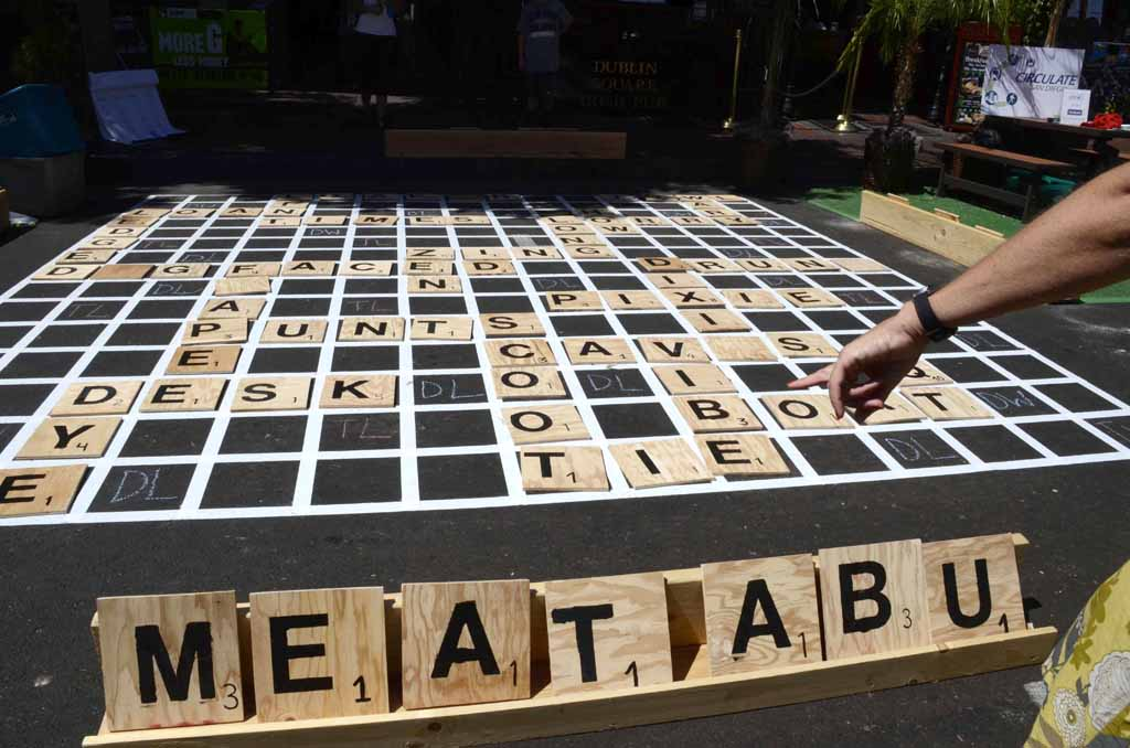 "The giant Scrabble game on Fourth Avenue was called an ""intensely popular"" stop for pedestrians on Park(ing) Day."