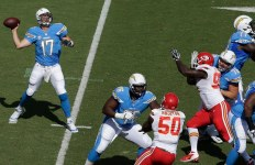 Philip Rivers attempts a pass against the Kansas City Chiefs. Courtesy of San Diego Chargers Facebook.