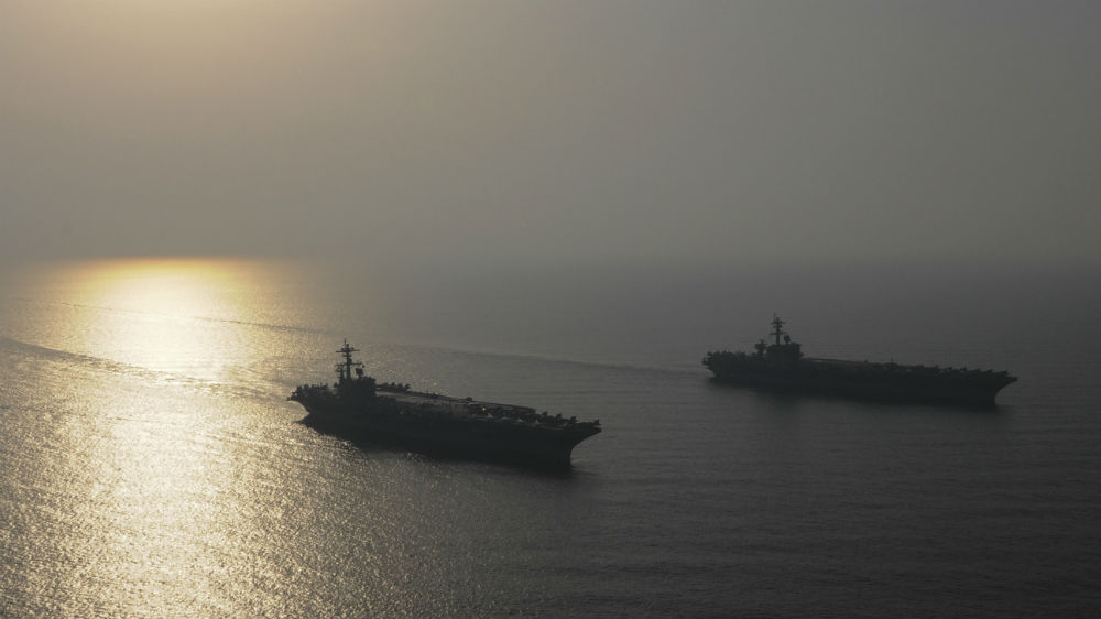 The aircraft carriers USS Carl Vinson and USS George H.W. Bush operating in the Arabian Gulf. Navy photo