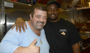 Owner Charlie Boghosian  poses with a kitchen employee.