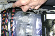 Border Patrol photo of 32 pounds of China white heroin hidden in an exhaust system.