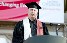 Facebook creative director Josh Higgins, a City College graduate, speaks at the college's commencement in May. Courtesy City College