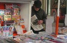 A newspaper vendor in London. Photo via Wikimedia Commons