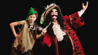 Adira Rosen as Peter Pan and Julia Price as Capt. Hook in the J Company production.