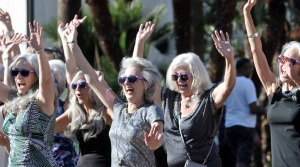 "Author Diana Jewell (center), founder of the Silver Sisters and author of the book ""Going Gray, Looking Great!"" leads the Silver Sisters Strut."