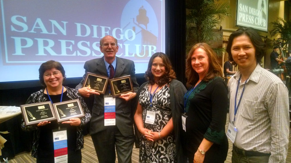 Current and former Times of San Diego editors Chris Stone (left), Ken Stone, Jennifer Vigil, Christine Huard and Alex Nguyen with awards. Photo by Chris Jennewein