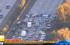 Protesters bock southbound Interstate 5 near Nobel Drive. Image from CBS8 broadcast