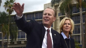 Mayor Kevin Faulconer and wife in Veterans Day parade. Photo by Chris Stone