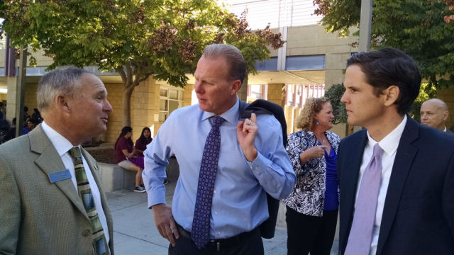 State schools superintendent candidate Marshall Tuck (right) and Mayor Kevin Faulconer listen to Preuss School Principal Scott Barton. Photo by Chris Jennewein