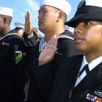 Military veterans taking the citizenship oath
