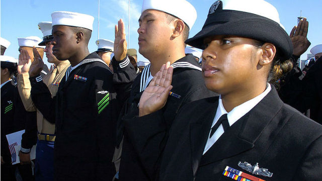Sailors and Marines take the oath of allegiance during a naturalization ceremony aboard the aircraft carrier USS Midway in 2008. Navy photo