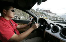 Patrick Hong test driving a Ferrari in Tibet. Courtesy photo