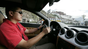 Patrick Hong test driving a Ferrari in Tibet. Courtesy photo