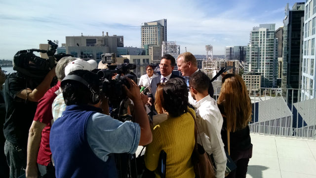 The two majors speak to a crowd of TV reporters after the signing. Photo by Chris Jennewein