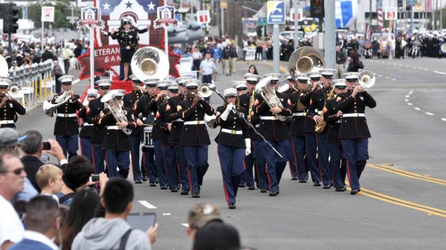 A Marine Corps Band leads the parade.