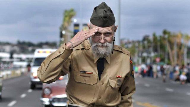 Veteran Richard Diestel walks the parade route.